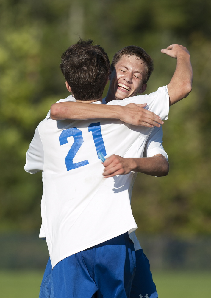 Kevin Bennett photo   Messalonskee's James Koulertsis, right, celebrates Ryan McCarthy's goal in the second half that gave the Eagles a 3-1 lead over Cony during a Kennebec Valley Athletic Conference Class A game Friday afternoon.