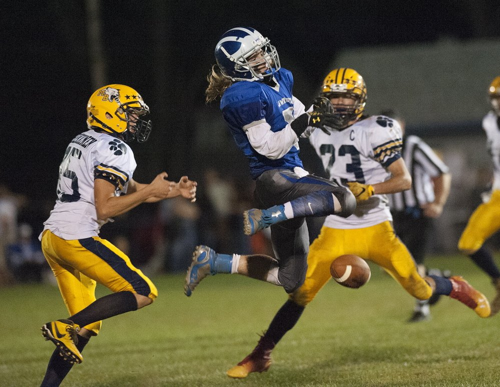 Lawrence's Walker Thomas has his catch broken up by Mt. Blue's Chase Heikkinen during the second quarter Friday in Fairfield.