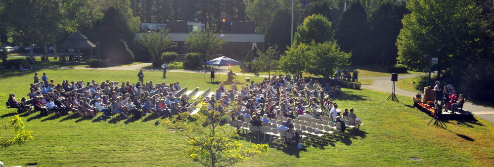People listen to speeches in the center of campus during the convocation Friday at the University of Maine at Augusta.