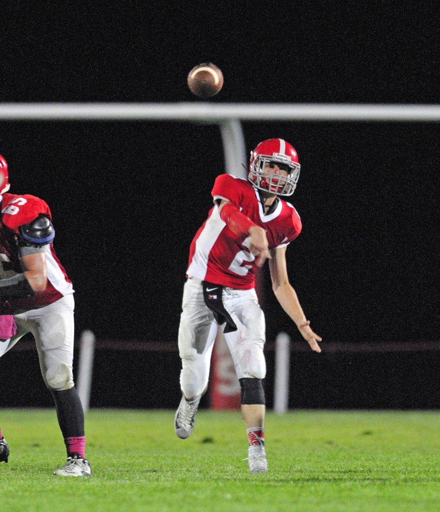 Staff photo by Joe Phelan   Cony quarterback Taylor Heath throws a pass during a Pine Tree Conference Class B game Friday night against Brunswick at Alumni Field in Augusta.