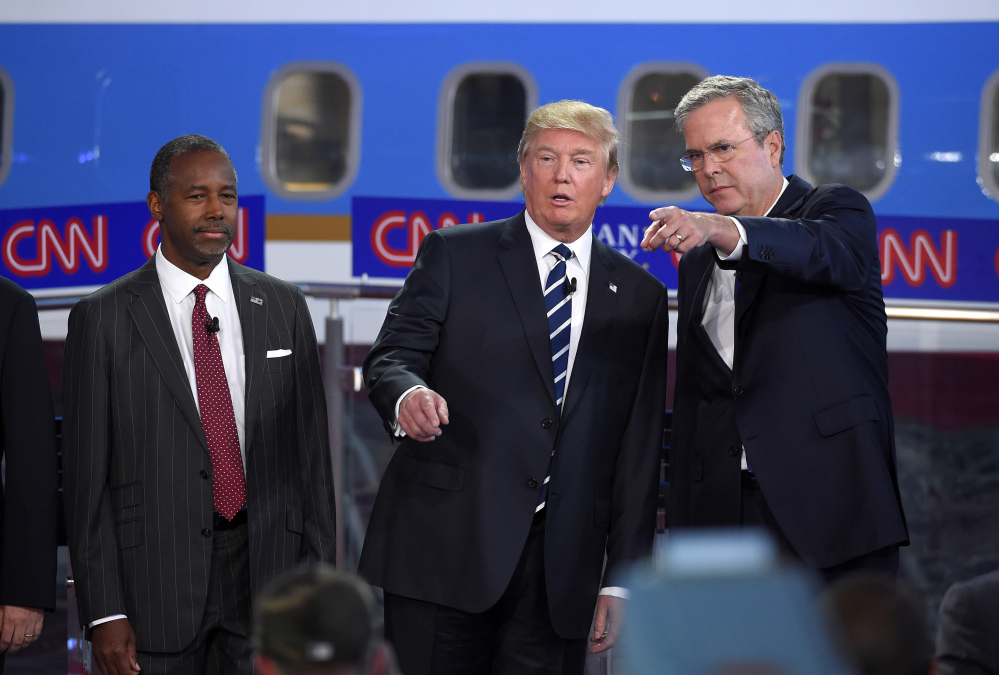 Republican presidential candidates, from left, Ben Carson, Donald Trump and former Florida Gov. Jeb Bush chat during the CNN Republican presidential debate at Wednesday. Trump's rivals emerged from the second Republican debate newly confident that the brash billionaire will fade if the primary takes a more substantive turn.