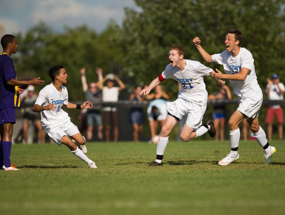 Contributed photo/Colby athletics Colby's Tim Stanton, Brandon Fahlberg and Kyle Douglas celebrate after they stunned Williams 2-1 in double overtime on Saturday in Waterville. It was the first victory over the Ephs in 15 years.