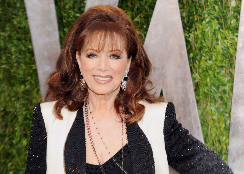 In this Feb. 24, 2013 file photo, author Jackie Collins arrives at the 2013 Vanity Fair Oscars Viewing and After Party in West Hollywood, Calif.