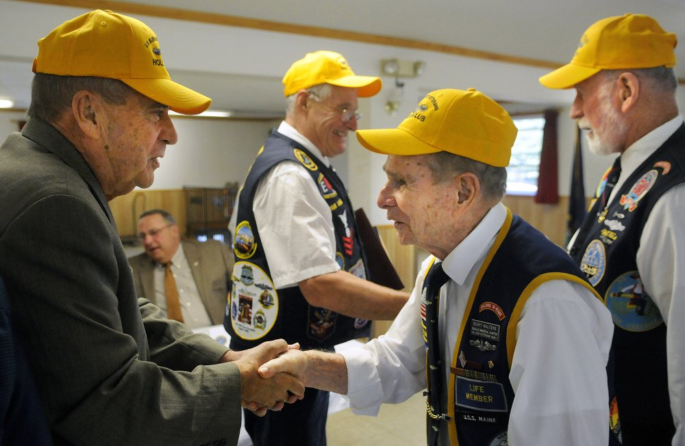 AUGUSTA, ME - SEPTEMBER 20: John Morris, left, is congratulated Sunday September 20, 2015 by Bucky Walters as Willis Clifford, right, congratulates Paul Talbot for their nomination to the The Holland Club, for submariners who survived 50 years after going to sea on a submersible boat, during a ceremony in Augusta.  Morris, Maine's Public Safety Commissioner and a resident of West Gardiner, served on the USS Tunny in 1965.  Talbot, a resident of Corinna, first qualified aboard the USS Clamagore in 1964.  Gov. Paul LePage, second from left, attended the event. (Staff photo by Andy Molloy/Staff Photographer)