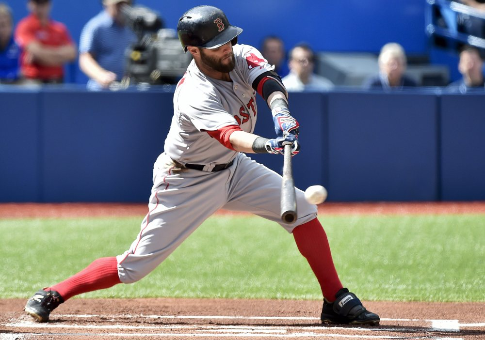 Boston Red Sox second baseman Dustin Pedroia hits a single against the Toronto Blue Jays during the first inning Sunday in Toronto.