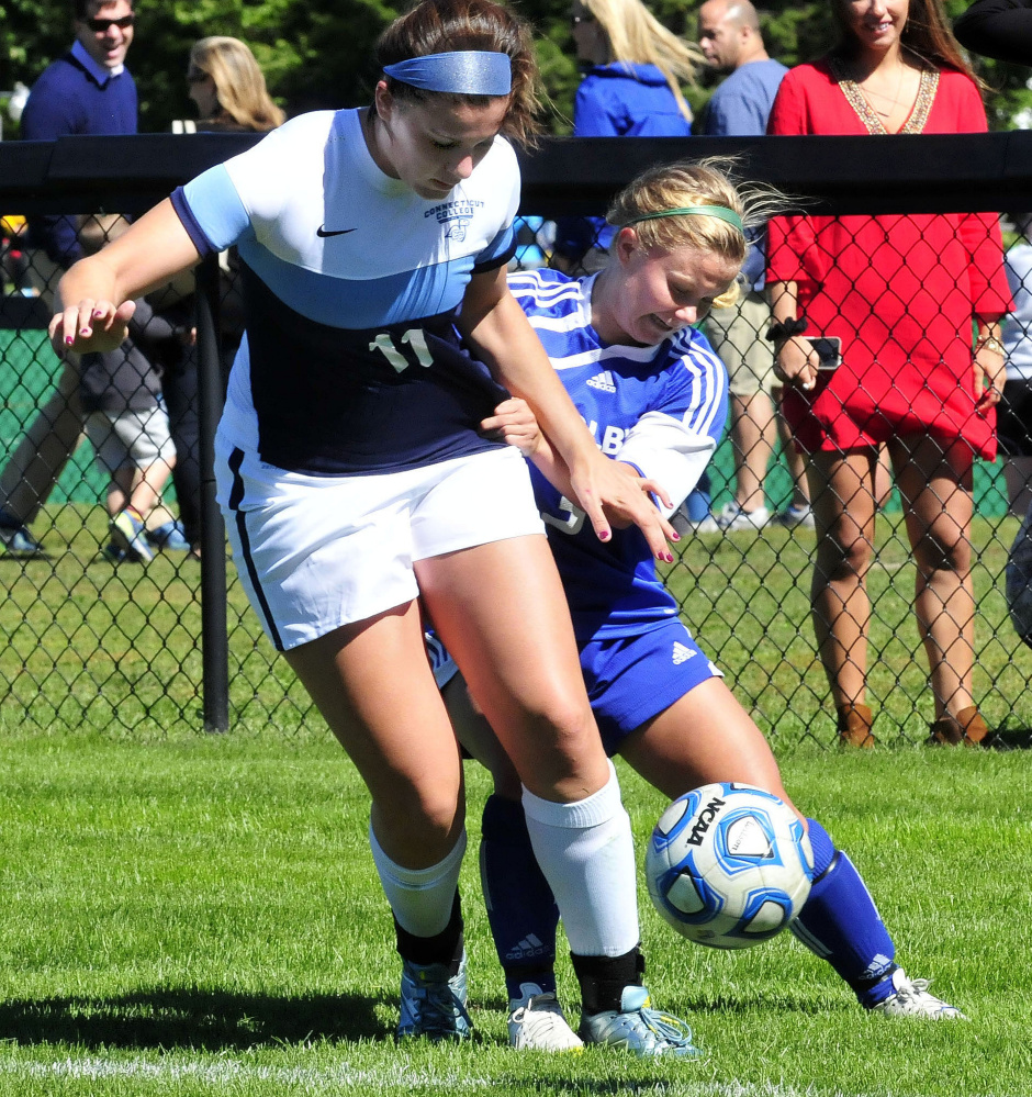 Colby 's Laura Arnold, right, and Connecticut College player Alex Bukovac fight for ball possession during a game Sunday.