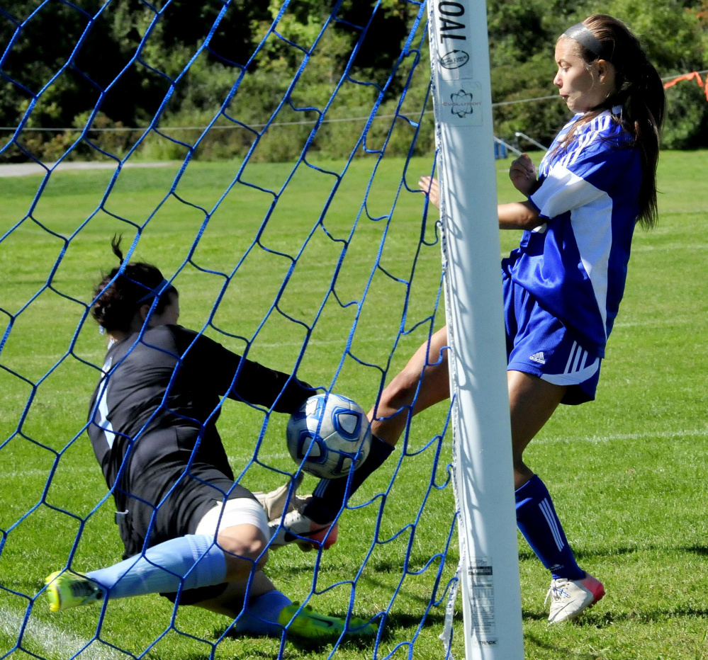 Colby's Hannah Brozdowski gets the ball past Connecticut College goalie Bryanna Montalvo during a game Sunday in Waterville.