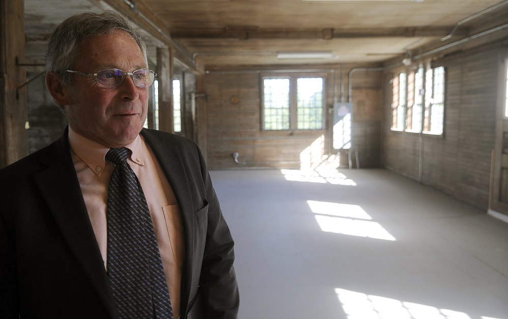 Walter E. Whitcomb, commissioner of the Maine Department of Agriculture, Conservation and Forestry, inspects the interior of the Campbell Barn in Augusta Monday during a dedication ceremony for the renovated structure at the state complex on the city's east side.