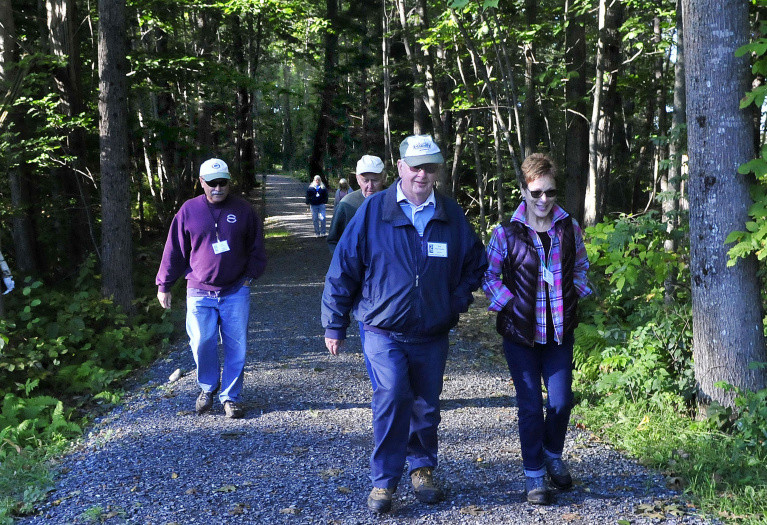These hikers regularly use the Rotary Centennial Trail, part of the Kennebec-Messalonskee Trail system in Benton on Monday. From left are Larry Genest, Ernie Baker, Bob Morrissette and Donna Genest.