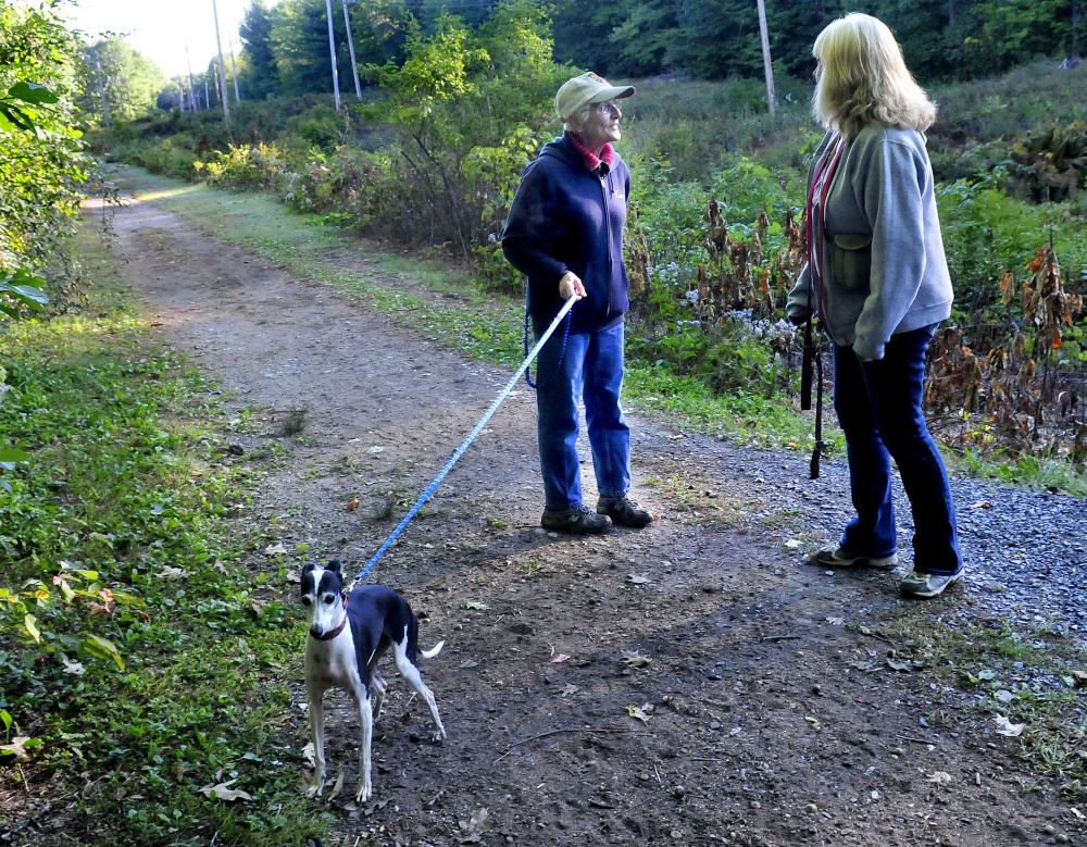 Tina Wentzel, left, and Judy McCaslin stop along the Rotary Centennial Trail in Benton to chat on Monday. Trail users say the walking trail is great for exercise and socializing for people of all ages.