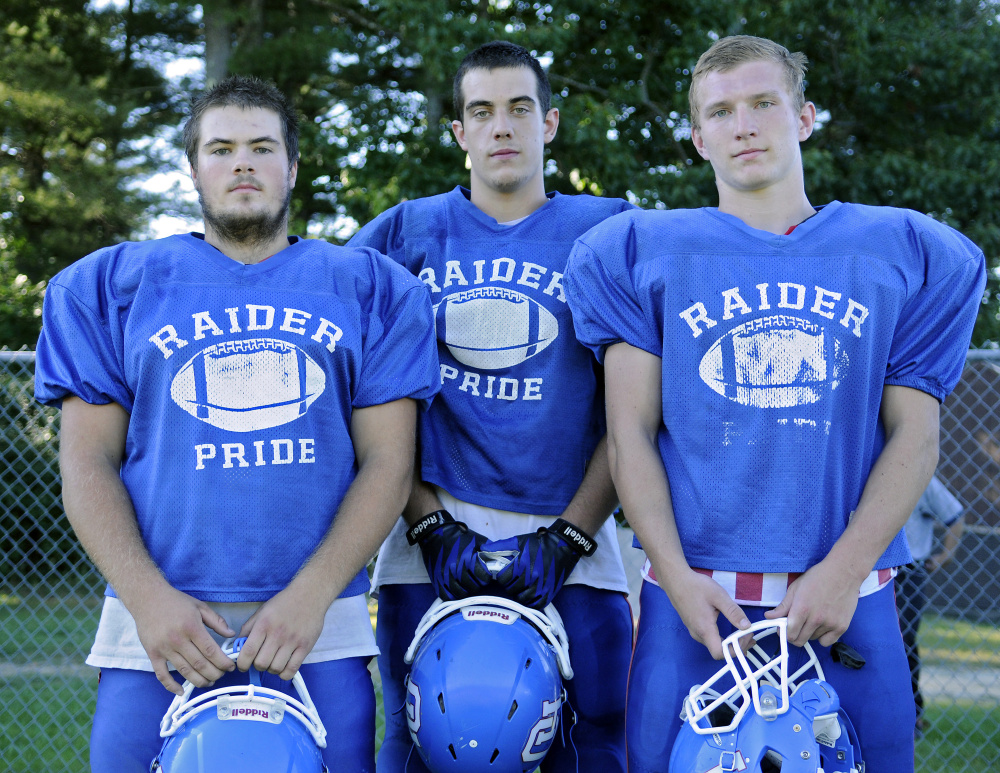 Oak Hill football players Garrett Gile, left, Austin Gaucher and Brendan Tervo give the Raiders depth on its offensive line, an advantage usually missing with Class D teams.