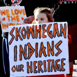 Skylar Carter joins a goupr to show support keeping the Indian nickname and mascot at Skowhegan High School in April. A group supporting keeping the nickname plans a Skowhegan Indian Pride rally on Columbus Day, while Maine Indians and their supporters are holding an Indigenous Peoples Day rally at Lake George in Skowhegna. The events are the latest surrounding the last school in the state that has Native American imagery.
