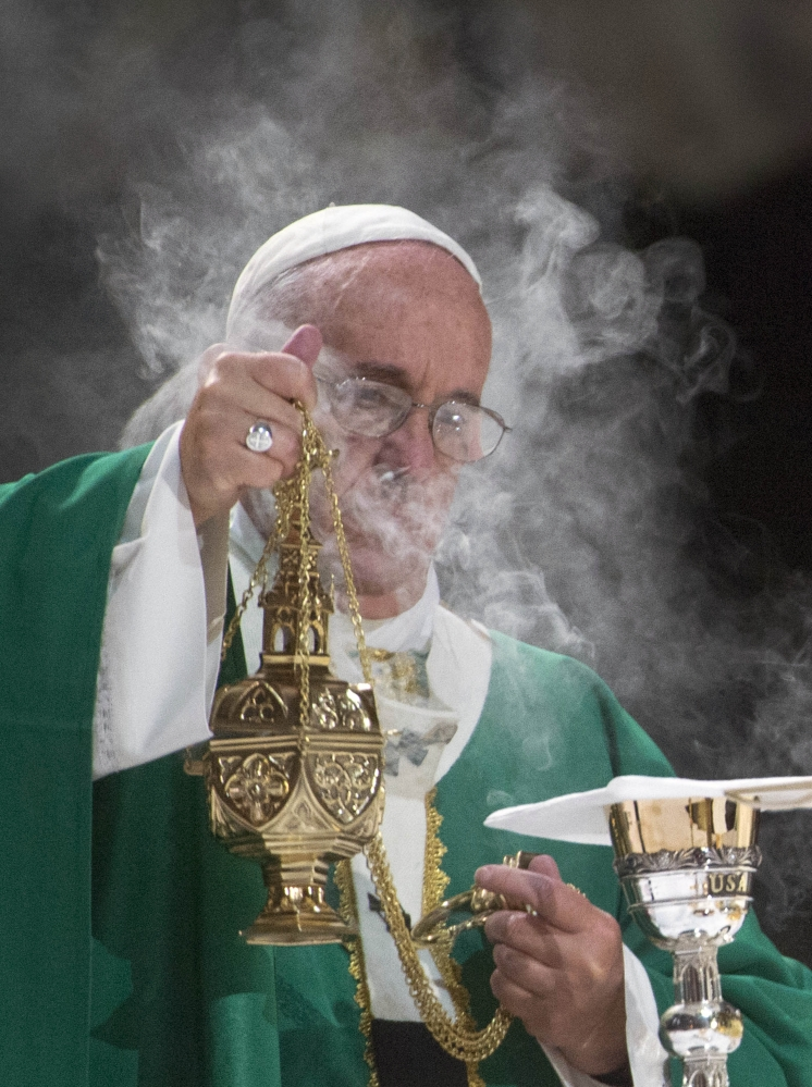 Pope Francis celebrates high Mass at Madison Square Garden on Friday evening.