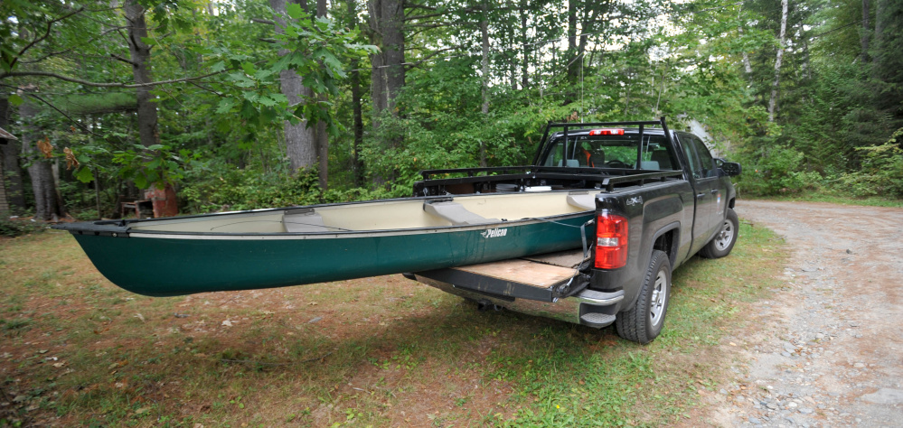 The canoe involved in a fatal accident on Lovejoy Pond in Albion on Friday sits in the back of Maine Warden's truck.