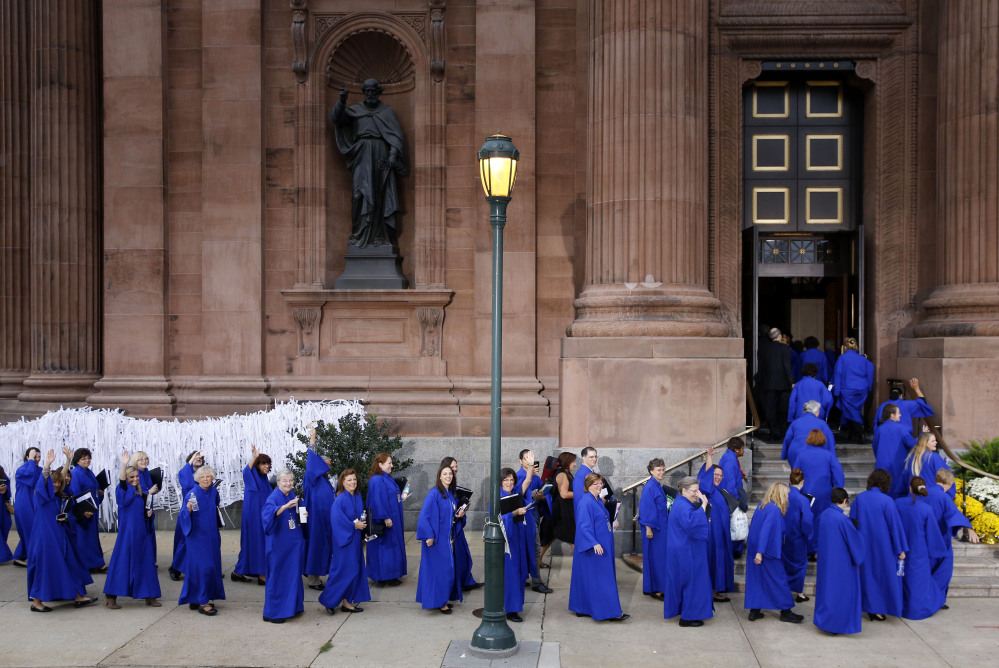 Members of a choir file into the Cathedral Basilica of Sts. Peter and Paul in Philadelphia, on Saturday before a Mass with Pope Francis.