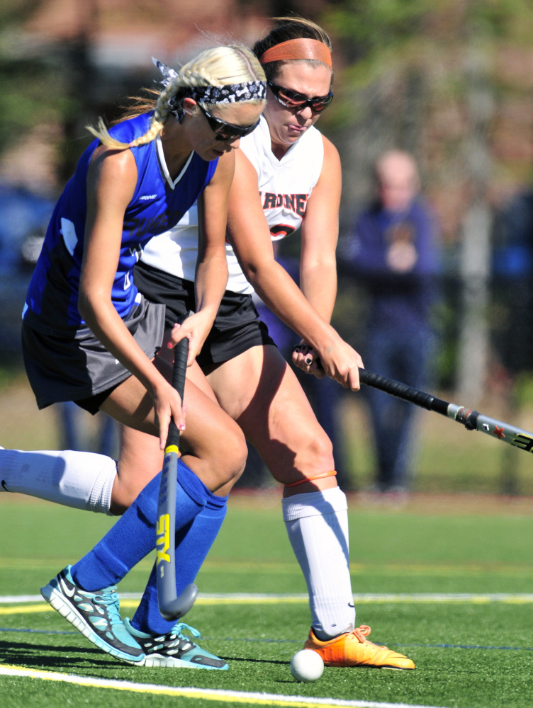 Staff photo by Joe Phelan   Lawrence's Hallee Parlin, left, tries to get around Gardiner defender Skye Lavoie during a Class B game Saturday at Thomas College.