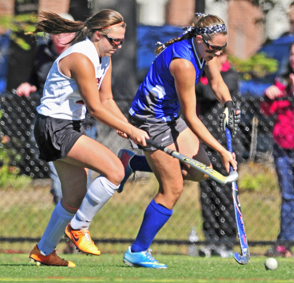 Staff photo by Joe Phelan   Gardiner's Skye Lavoie, left, tries to stop a run by Lawrence's Alexis Chamberlain during a Class B game Saturday at Thomas College.