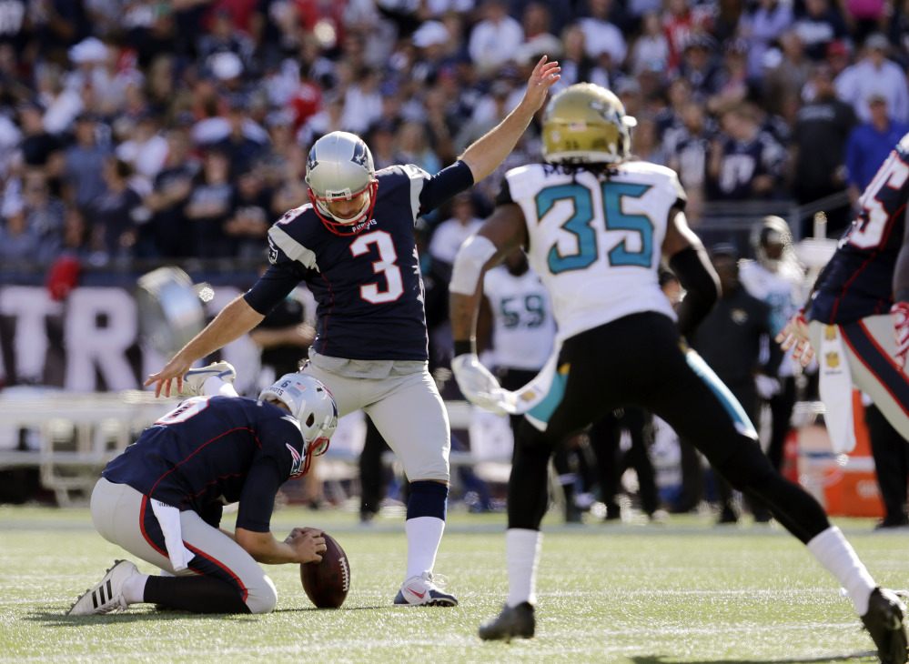 New England Patriots kicker Stephen Gostkowski (3) kicks his 423rd consecutive point after a touchdown to set a new NFL record in the second half against the Jacksonville Jaguars on Sunday in Foxborough, Mass.
