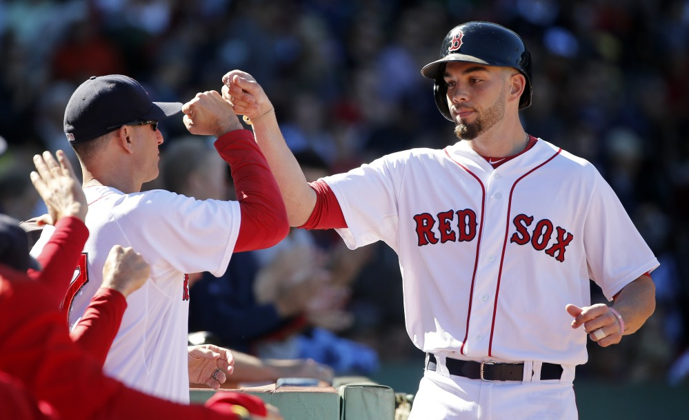 Boston's Blake Swihart, right, celebrates his solo home run with interim manager Torey Lovullo during the third inning against the Baltimore Orioles on Sunday in Boston.