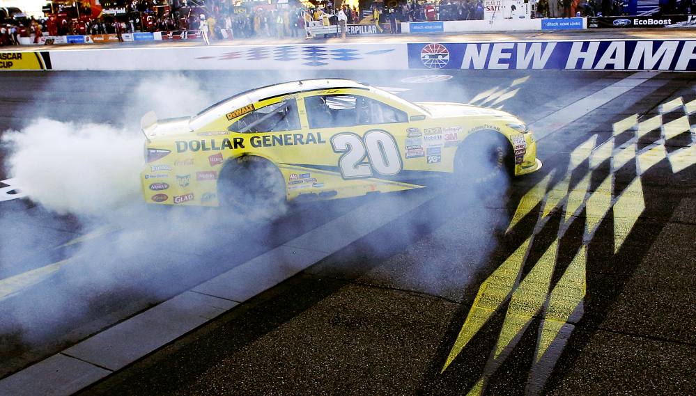Matt Kenseth celebrates at the finish line after winning the NASCAR Sprint Cup race Sunday at New Hampshire Motor Speedway in Loudon, N.H.