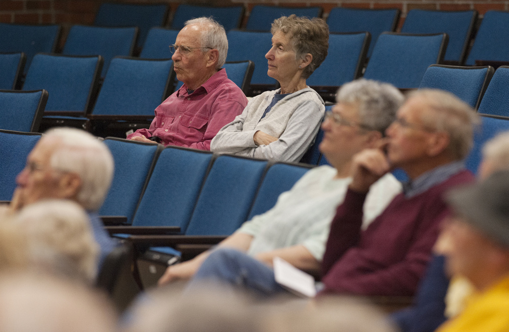 Michael Levey, left, and Michael Brown, both of Winthrop, listen during a public forum on end-of-life decisions held at Jewett Auditorium at the University of Maine in Augusta on Sunday.