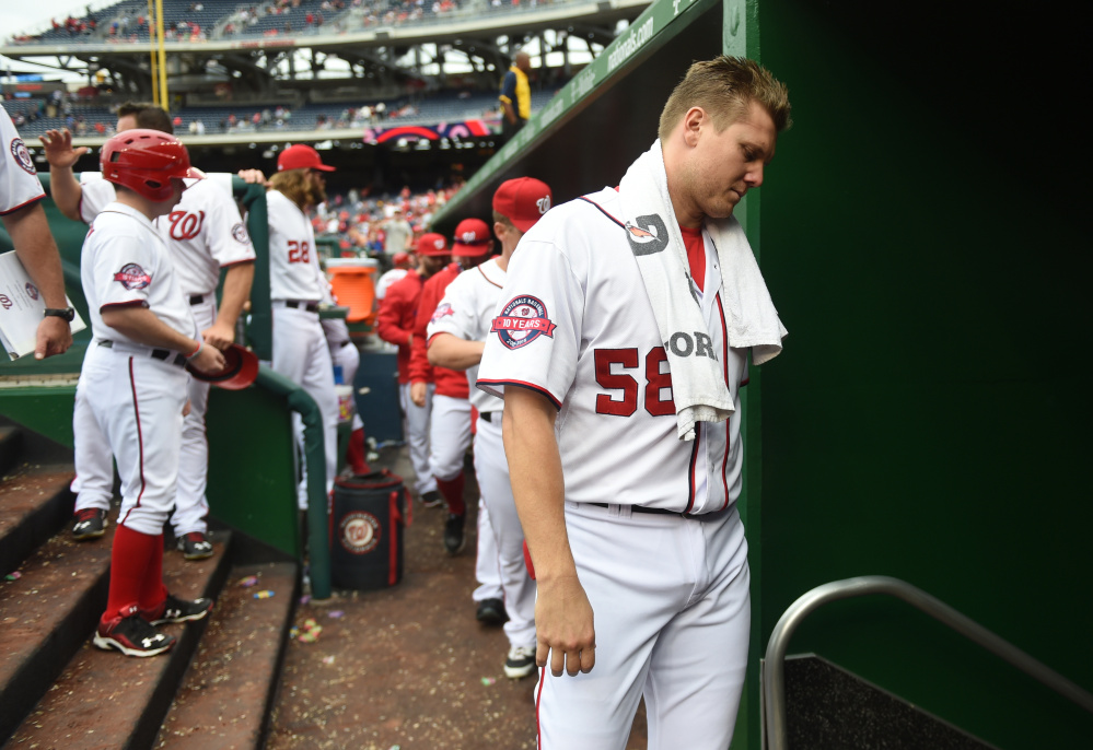 Washington Post photo by Jonathan Newton   Washington Nationals relief pitcher Jonathan Papelbon leaves the dugout following their loss to the Phillies on Sunday. The Nats suspended Papelbon four games for his role in a fight with teammate Bryce Harper.
