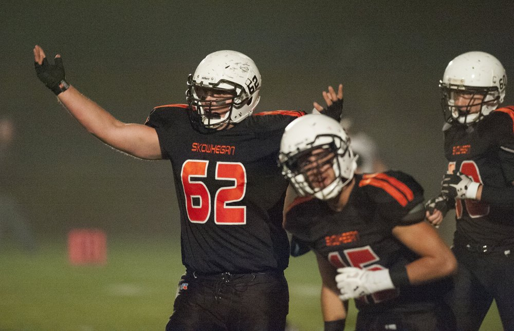 Kevin Bennett photo   Skowhegan's Owen Boardman (62) celebrates after Skowhegan's first touchdown of a Pine Tree Conference Class B game against Brewer last Friday night at Skowhegan. The Indians prevailed, setting up a showdown in Brunswick on Friday night.
