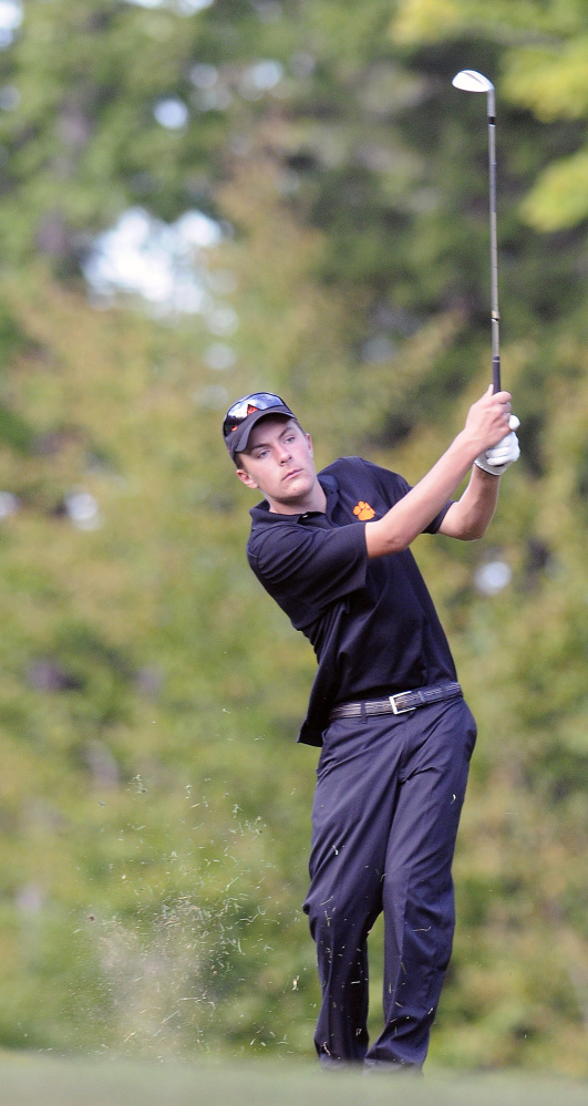 Staff photo by Andy Molloy   Gardiner Area High School's Chad Prince tees off during a Kennebec Valley Athletic Conference Class B semifinal match against Lincoln on Monday afternoon at the Meadows.