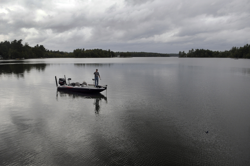 "Jim Landry of Wilton tosses a plug while bass fishing Tuesday beneath overcast skies on Lake Cobbessee in Manchester. Several inches of rain is forecast for the remainder of the week, according to the National Weather Service. Despite the threat of getting wet in the days ahead, Landry said, ""I might venture out to fish."""