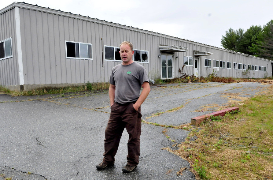 John Black speaks outside the former Wilton Tanning company on Tuesday. He bought the property in May and plans to renovate for his business ventures and lease space to other businesses. The town is holding a ribbon-cutting Thursday.