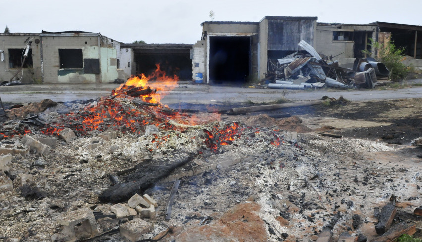 A debris is burned behind the former Witlon Tanning company on Tuesday. New owner John Black is repairing and renovating the large structure including roof replacement for his businesses and other companies.