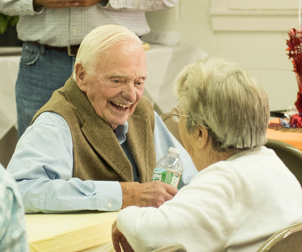 """Frederick """"Freddy"""" W. Weston, Jr. visits with family, friends and neighbors at the Rome Community Center."""