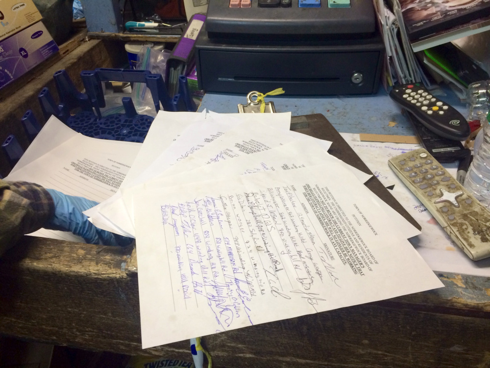 A petition at Triple D Redemption in Norridgewock, seen Wednesday, seeks signatures in calling for Town Manager Michelle Flewelling's contract to not be renewed.
