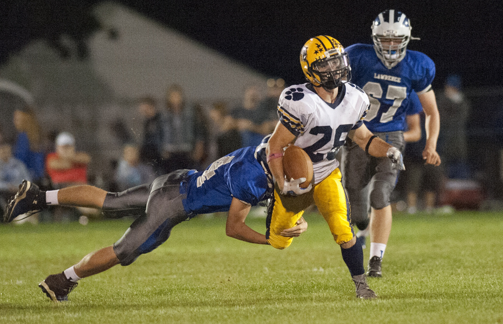 Kevin Bennett photo   Mt. Blue running back Christian Whitney heads the up field during a Pine Tree Conference Class B game against Lawrence earlier this season.