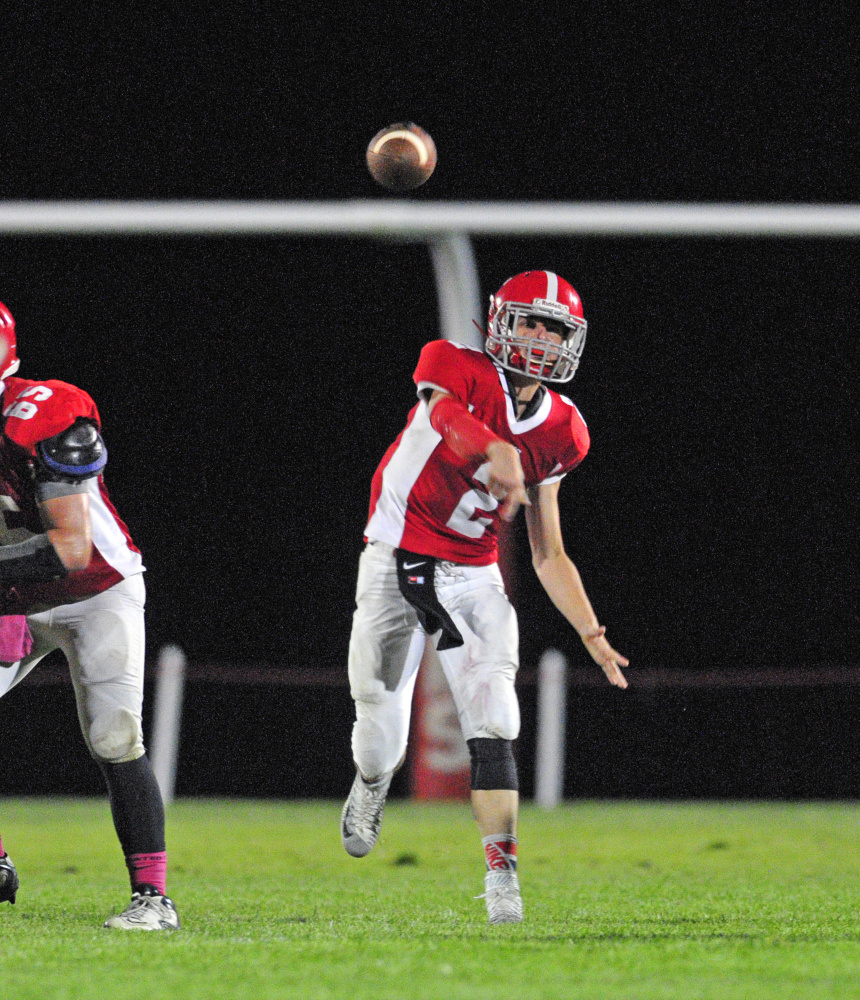 Staff photo by Joe Phelan   Cony quarterback Taylor Heath throw a pass during a game against Brunswick at Alumni Field in Augusta on Sept. 18.