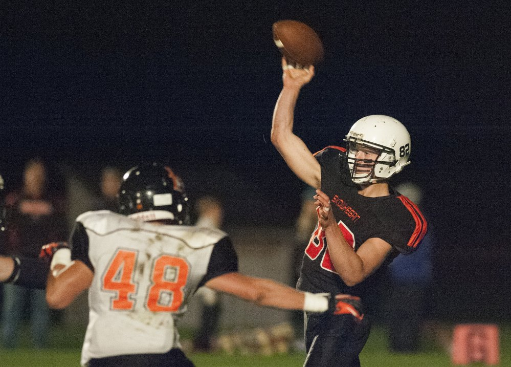 Kevin Bennett photo   Skowhegan's Garrett McSweeney throws a pass during a Pine Tree Conference Class B game against Brewer last Friday night in Skowhegan.