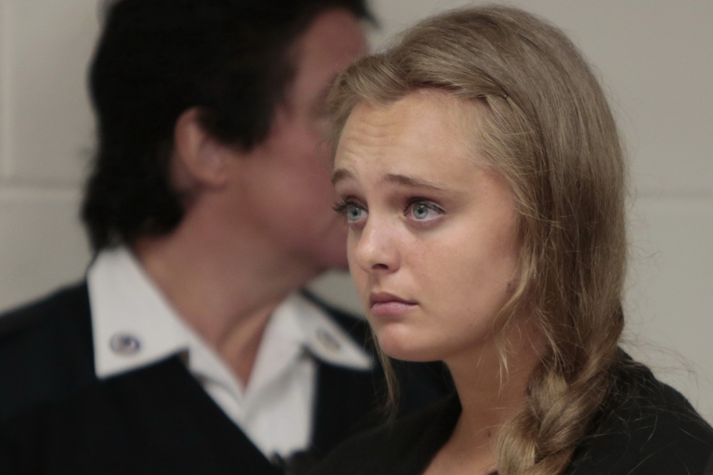 Michelle Carter listens to attorney Joseph P. Cataldo argue for dismissing involuntary manslaughter charges against her at Juvenile Court in New Bedford, Mass., last week.