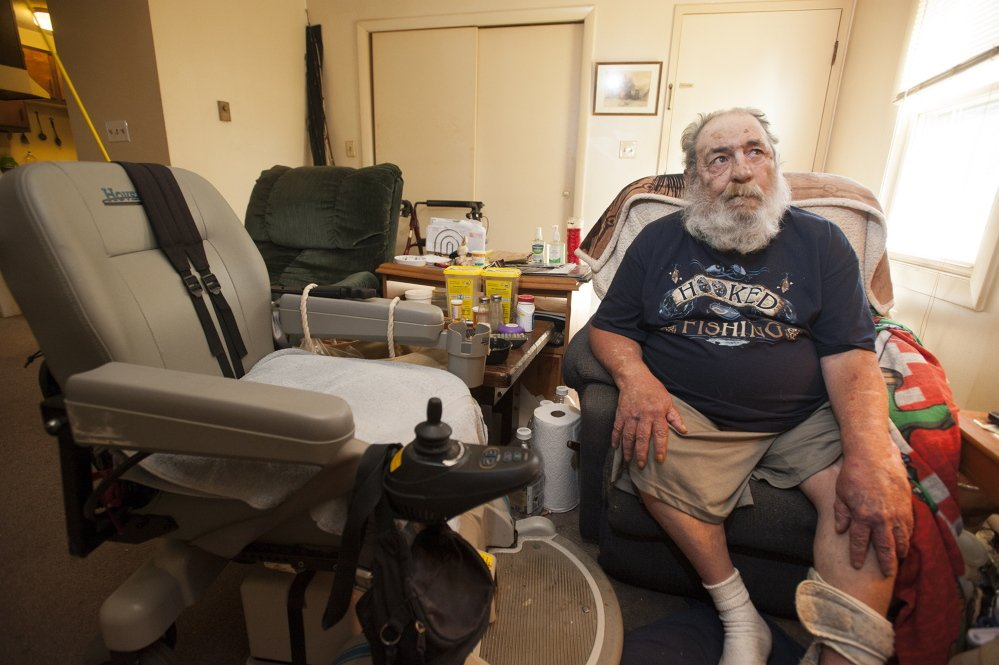 Harvey Lembo sits in an armchair in his living room in Rockland, next to his wheelchair, on Tuesday. Lembo allegedy shot Christopher Wildhaber after Wildhaber broke in and told Lembo he was there to rob him.