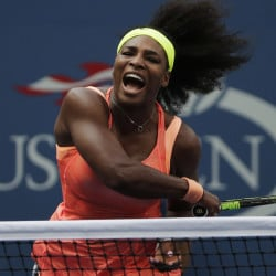Serena Williams follows through on a return to Kiki Bertens of the Netherlands on Wednesday as she overcame service errors for a 7-6 (7-5), 6-3 win in the second round of the U.S. Open at New York.