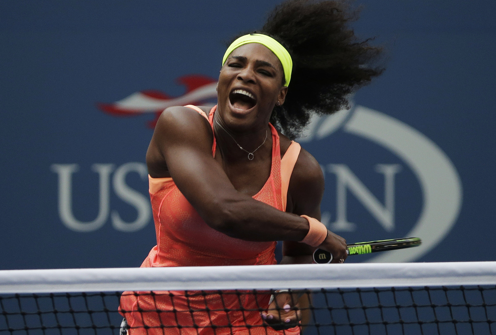 Serena Williams follows through on a return to Kiki Bertens of the Netherlands on Sept. 2 as she overcame service errors for a 7-6 (7-5), 6-3 win in the second round of the U.S. Open at New York.