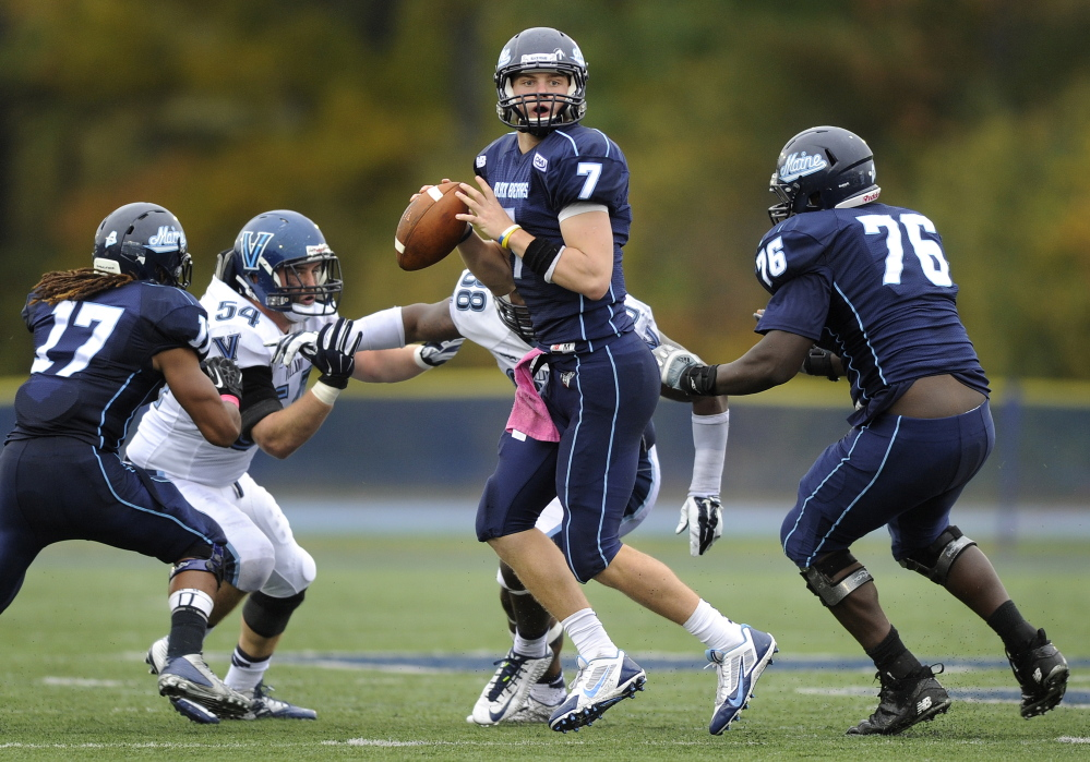 Maine quarterback Dan Collins steps up in the pocket to throw late in the fourth quarter of a 41-20 loss to Villanova at Alfond Stadium in Orono on Oct. 4, 2014.