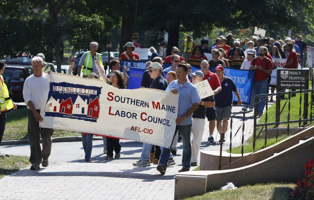Members of the Southern Maine Labor Council lead a Labor Day march Monday in Portland.
