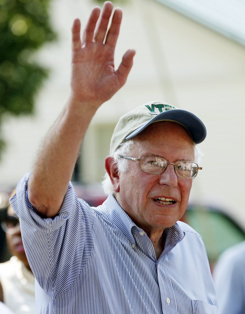 Democratic presidential candidate Sen. Bernie Sanders, I-Vt, waves as he walks in the Labor Day parade Monday, Sept. 7, 2015, in Milford,N.H. (AP Photo/Jim Cole)