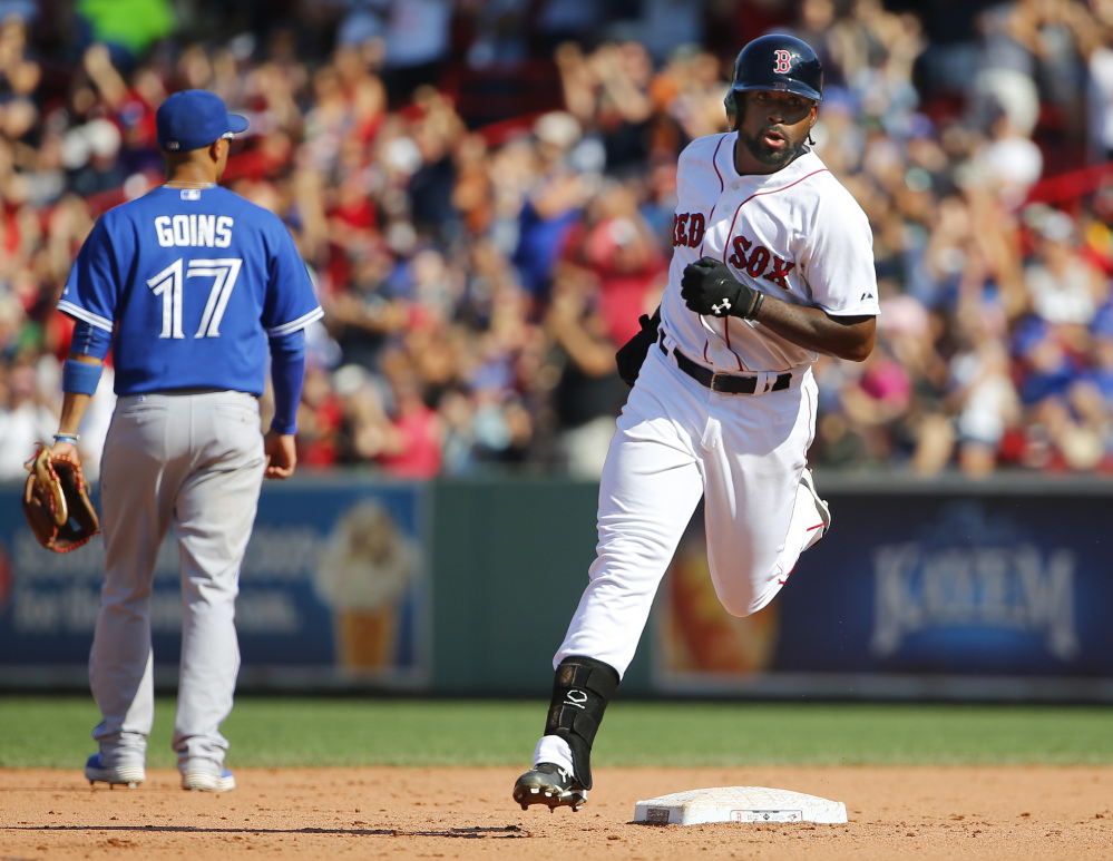 Boston's Jackie Bradley Jr. rounds the bases after his two-run home run in the sixth inning. Bradley has 24 extra-base hits in his last 25 games.