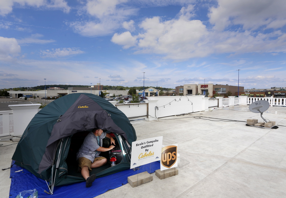 Kevin Fitzpatrick of Scarborough has been camping on the roof of Jimmy the Greek's at the Maine Mall since Friday as a part of a fundraiser for STRIVE, a program designed to address the many issues of young people with developmental disabilities. He says he will remain on the roof until he reaches his goal of $20,000.