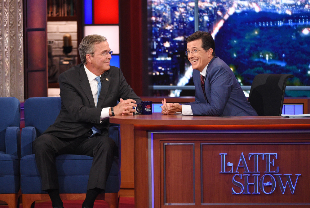 "Stephen Colbert talks with Republican presidential candidate Jeb Bush during the premiere episode of ""The Late Show"" on Tuesday in New York. Bush and actor George Clooney were the guests for Colbert's debut."