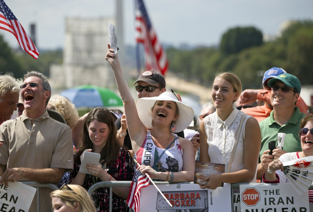 "Kimberlee Crawford of Los Angeles, center, cheers as she attends a rally – led by Donald Trump and Ted Cruz – against the Iran deal Wednesday outside the Capitol in Washington. ""We are led by very, very stupid people,"" Trump said. ""We cannot let it continue."""