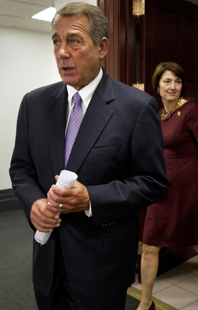 Speaker of the House John Boehner of Ohio walks into a news conference about the Iran deal after meeting with Republicans in Washington.