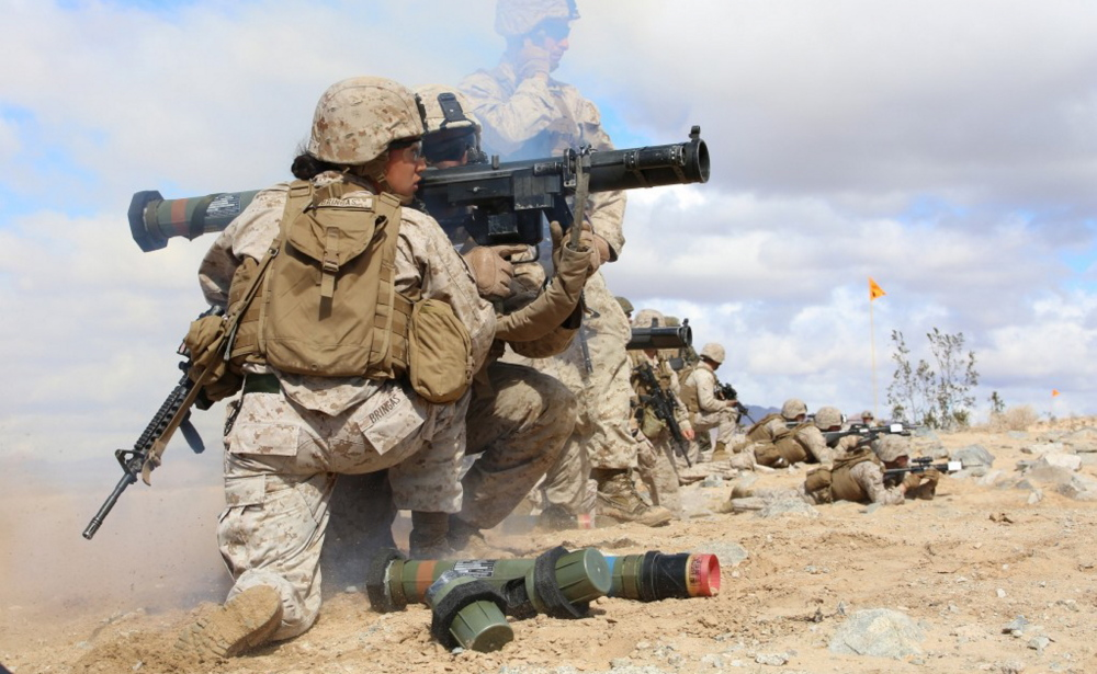 Marine Sgt. Emma A. Bringas and Lance Cpl. Terrence A. Lay fire an assault weapon during a pilot test of the Ground Combat Element Integrated Task Force, a unit created by the Marine Corps to see how women could better be included in combat units.