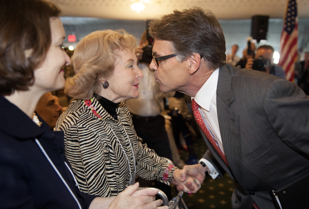 Republican presidential candidate and former Texas Gov. Rick Perry is greeted by audience members after speaking at an event sponsored by the Eagle Forum in St. Louis on Friday. During the speech Perry said he is ending his second bid for the Republican presidential nomination.